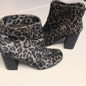 Not rated leopard boots. Sz7